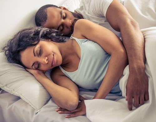 couple sleeping soundly after having sleep apnea treated