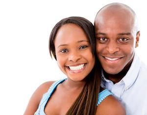 young couple facing forward with bright smiles I dental fillings at galloway smiles