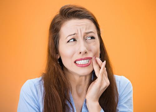 woman in pain from dental emergency