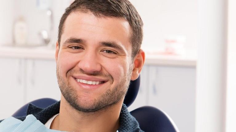 Man smiling in dental exam chair