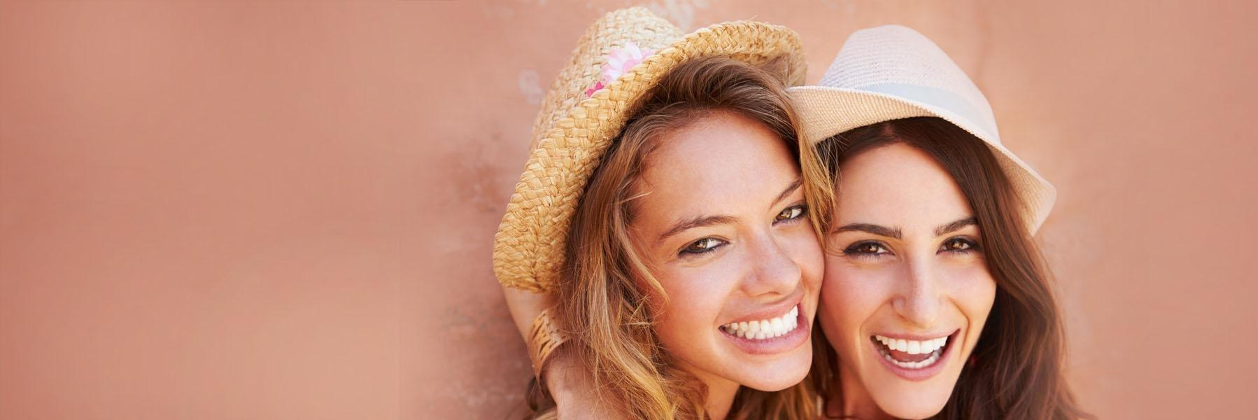 Women with hats smiling